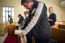 Church members and guests pray during worship Feb. 14 at St. Peter Lutheran Church in Mexico City.