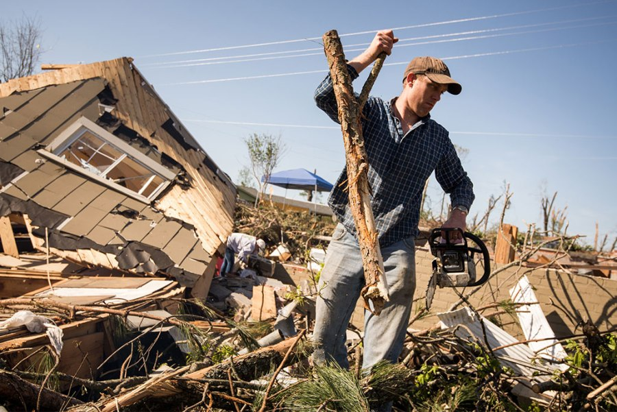 "John Gorman removes debris from a tornado-destroyed home in Tupelo, Miss., on May 2, 2014. ""LCMS Camp Courage: A Place of Hope and Healing"" — a weeklong vacation Bible school program designed to help traumatized children rebound from disasters — is the Synod's latest ""crowdfunding"" project. Its goal is to raise a total of $6,430 by June 14. (LCMS/Erik M. Lunsford)"