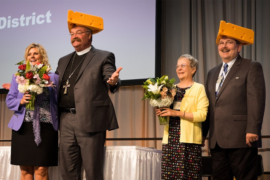 The Rev. Dr. Matthew C. Harrison, president of the LCMS; his spouse, Kathy Harrison; the Rev. Herb Mueller, the re-elected LCMS first vice-president; and his spouse, Faith Mueller, react after receiving foam cheeseheads on Sunday, July 9, 2016, in Milwaukee during the 66th Regular Convention of The Lutheran Church–Missouri Synod. (LCMS/Michael Schuermann)