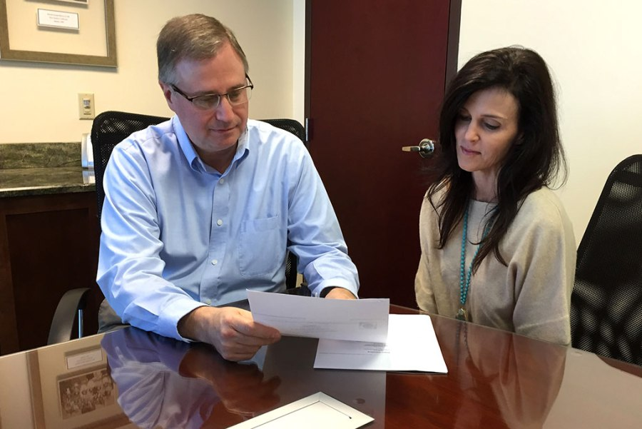 "The LCMS Florida-Georgia District is saving $2,000 in annual fees since moving from a commercial bank to the Lutheran Federal Credit Union, says district Business Manager John Elliott, going over paperwork with bookkeeper Laura Zirbel. He calls the savings ""money we can now use for the district's mission to serve, assist and encourage congregations in the ministry of Jesus Christ."" (LCMS Florida-Georgia District)"