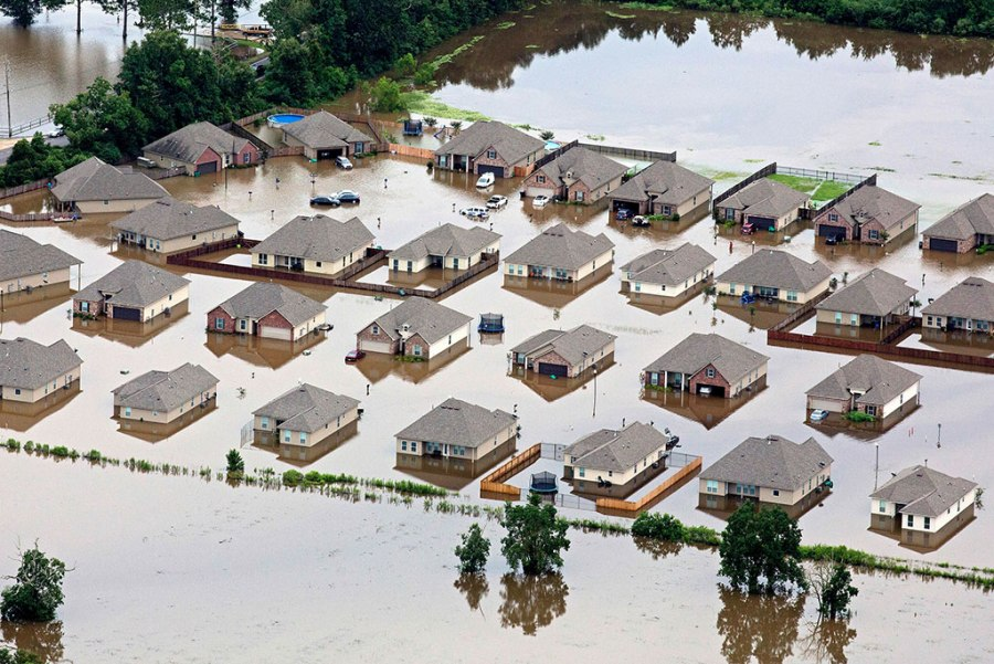 In this aerial photo over Hammond, La., flooded homes are seen off of LA-1064 after heavy rains inundated the region Aug. 13. (AP Photo/Max Becherer)