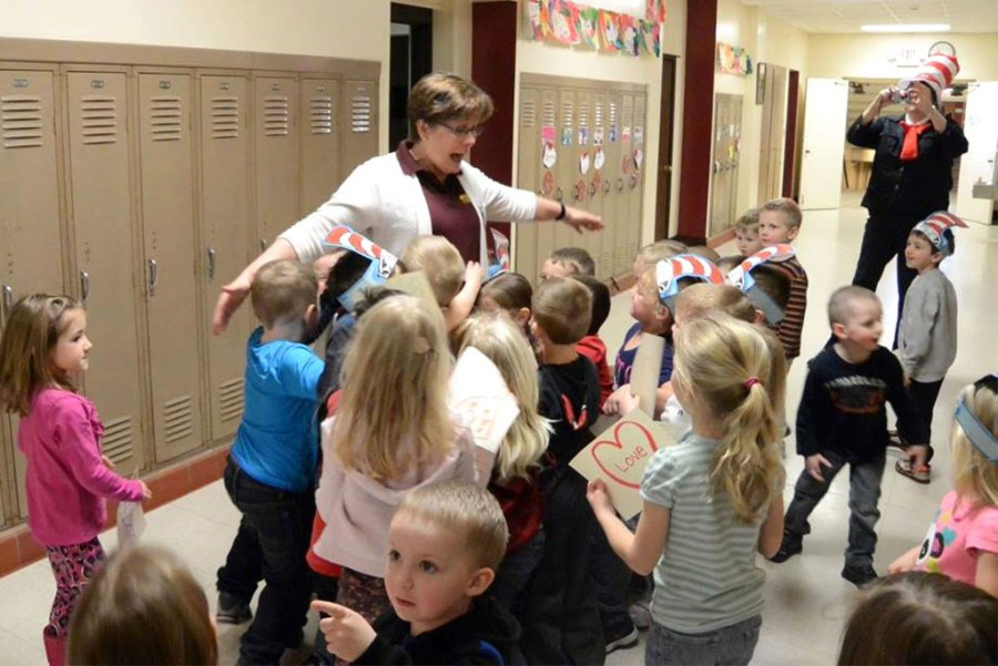Susan Longmire, principal of St. James Lutheran School in Shawano, Wis., gets a birthday hug in March from 3-year-old preschool students. Longmire will be honored in Washington, D.C., in October as one of the nation's best elementary school principals. (Kim Klement)
