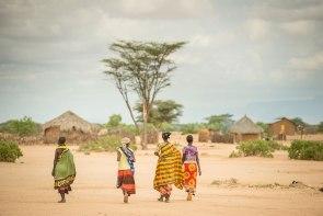 Women walk to their homes near Lodwar, Kenya.