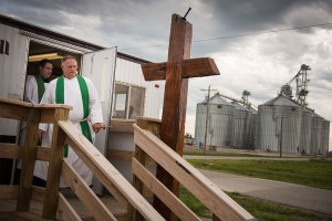 The Rev. Terry Makelin, pastor of St. John's Lutheran Church, and the Rev. Michael Meyer, manager of LCMS Disaster Response, walk down the stairs of the temporary church office of St. John's on June 16, 2015, as the new church building remained under construction a year after dual EF-4 tornadoes destroyed the church. (LCMS/Erik M. Lunsford)