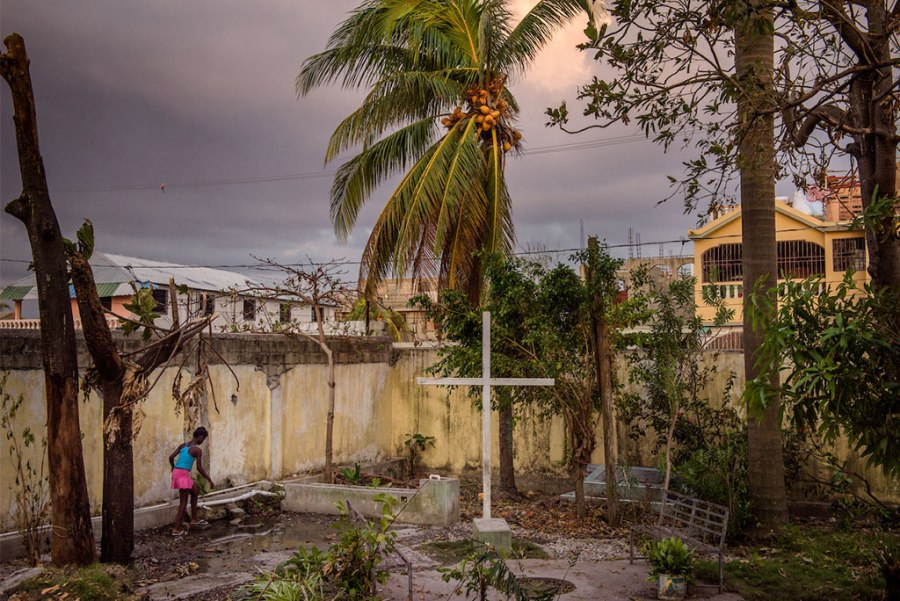 A young woman walks to the water well amid fallen debris from Hurricane Matthew in the entranceway to First Lutheran Church of Les Cayes in Haiti, Oct. 11. LCMS Disaster Response is working to provide an initial 10 wells, with a goal of providing up to 50 wells for clean water amid an outbreak of cholera that followed the hurricane. (LCMS Communications/Erik M. Lunsford)
