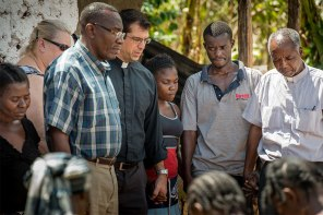 The Rev. Ross Johnson prays with hurricane victims at a home in Duchity, Haiti, Oct. 12. What distinguishes LCMS Disaster Response from other agencies responding to the crisis is the emphasis on providing spiritual care and the comfort of the Gospel to those suffering in the aftermath of catastrophes like hurricanes.