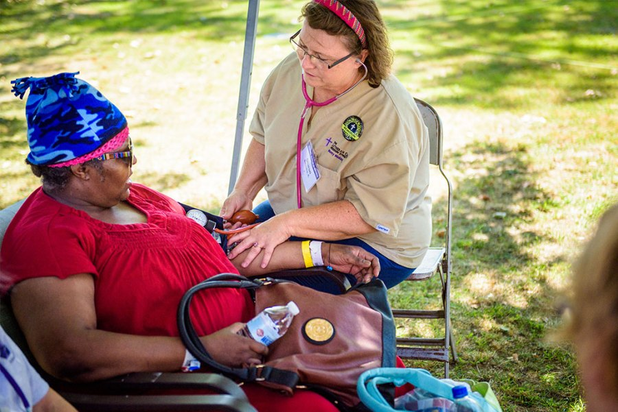 Sharon Thomas, a nurse from Belvidere, Ill., and board chair of Lutherans in Medical Missions, takes a woman's blood pressure during the Synod's first domestic Mercy Medical Team health fair Aug. 26-27 at Shepherd of the City Lutheran Church in Philadelphia. (LCMS/Erik M. Lunsford)