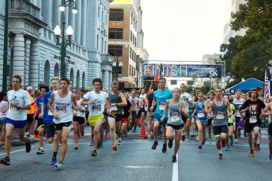 "Youth and adult participants run in downtown New Orleans during the 2016 LCMS Youth Gathering 5K on July 17. The ""Run for Welcome"" event was sponsored by Lutheran Immigration and Refugee Service, with registration proceeds going toward its work with refugees and immigrants. (LCMS Youth Gathering/Nathan Harrmann)"
