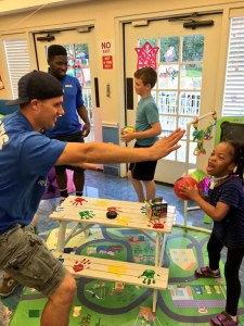 Graham Barber, director of Youth Ministries at Our Savior Lutheran Church and School in St. Petersburg, Fla., plays basketball with a resident at Sabal Palms, a local pediatric nursing home. (Cassie Moore/Our Savior Lutheran Church and School)
