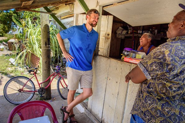 Meissner visits with new friends at their shop across the road from Seine Bight's primary school.