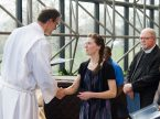 """Rebecca Schaff, national missionary to Minneapolis, receives from the Rev. Steven Schave a certificate noting her completion of missionary orientation during the March 17 """"Service of Sending"""" in St. Louis. Schave is director of LCMS Church Planting and Urban & Inner-City Mission. (LCMS/Frank Kohn)"""