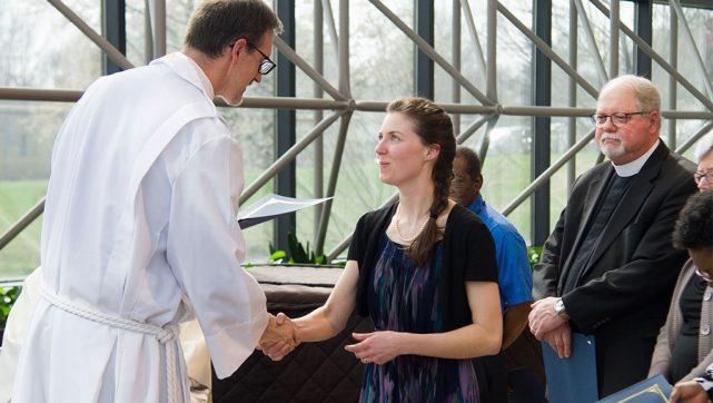 "Rebecca Schaff, national missionary to Minneapolis, receives from the Rev. Steven Schave a certificate noting her completion of missionary orientation during the March 17 ""Service of Sending"" in St. Louis. Schave is director of LCMS Church Planting and Urban & Inner-City Mission. (LCMS/Frank Kohn)"