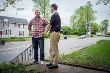 The Rev. Micah Glenn (left), new national missionary to Ferguson, talks about his hometown neighborhood with the Rev. Steve Schave, director of LCMS Urban & Inner-City Mission (UICM) and director of LCMS Church Planting, outside his parents' home on Wednesday, April 20, 2016, in Ferguson, Mo.