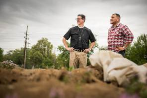 The Rev. Micah Glenn (right), new national missionary to Ferguson, stands Wednesday, April 20, 2016, with the Rev. Steve Schave, director of LCMS Urban & Inner-City Mission (UICM) and director of LCMS Church Planting, on the site of the former QuikTrip store in Ferguson, Missouri, which burned down amongst the unrest following the shooting death of Michael Brown almost two years ago. The Lutheran Hope Center of Ferguson will be built at the site.