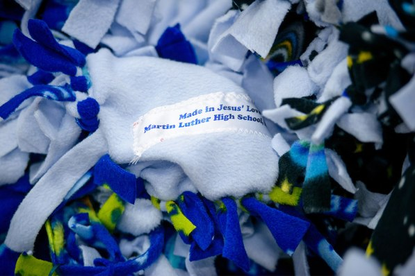 "Blankets made by Northrop, Minn., high-school students for local agencies carry tags noting that they were ""made in Jesus' love."""