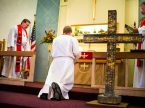 "The Rev. Timothy Mueller, pastor of St. John's Lutheran Church, kneels to pray at the altar on Sunday, August 9, 2015, during a ""Day of Thanksgiving and Rededication""  at the church in New Minden, Ill. Nearly two years ago, a tornado damaged the church and surrounding homes. Mueller is joined by the Rev. Dr. Herbert C. Mueller Jr. (left), first vice-president of The Lutheran Church–Missouri Synod, the Rev. Dr. Matthew C. Harrison, president of the LCMS (right), and the Rev. Jacob Mueller of Holy Cross Lutheran Church in Emma, Mo (next to Harrison). LCMS Communications/Erik M. Lunsford"