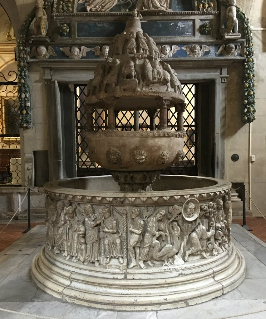 The baptismal font at the Basilica of San Frediano in Lucca, Italy; photo credit: Tom Eggebrecht