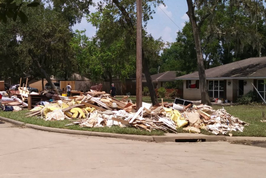 After the storm: Homes in Friendswood, ruined by feet of standing water, are being emptied of everything, Photo credit: Jennifer Davis