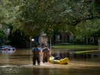 Residents in Houston use boats to access their flooded homes on Friday, Sept. 1. (LCMS/Erik M. Lunsford)