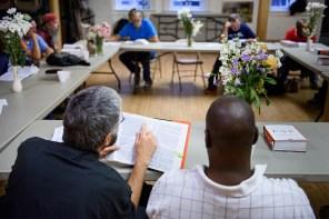 The Rev. John Suguitan leads Bible study for Prince of Peace's Bridge Ministry in Cincinnati.