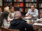 """The Rev. Dr. John A. Nunes, right, president of Concordia College—New York in Bronxville, N.Y., talks with students during a class. This fall the school — which touts """"radical hospitality"""" and a """"student-first mentality"""" — saw a 35-percent increase in enrollment. (Concordia College—New York)"""