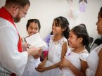 The Rev. Eddie Hosch, LCMS career missionary to Peru, confirms joyful new members at Castillo Fuerte on Saturday, Nov. 4, 2017, in the La Victoria district of Lima, Peru. (LCMS Communications/Erik M. Lunsford)