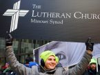 Zachary Treece proudly carries and LCMS sign during the Chicago March for Life on Jan. 14. (LCMS/Pamela Nielsen)
