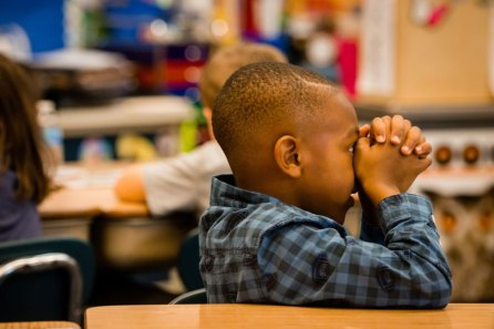 A student at St. John's Lutheran School prays before lunch on Nov. 15, 2017, in Racine, Wis. (LCMS/Erik M. Lunsford)