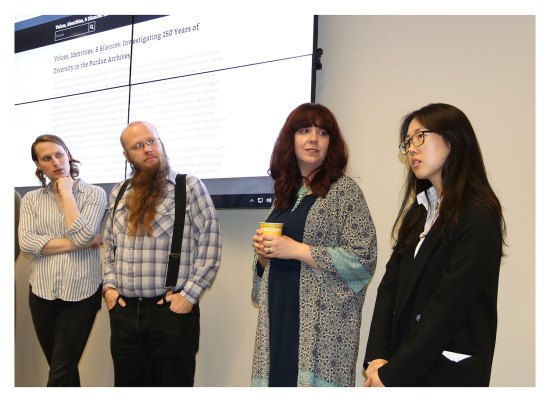 """Dee McCormick, E. C. McGregor Boyle III, and Elise Robbins, listen to Narim Kim as she discussed her work on the """"Foreign Teaching Assistants in the 1980s"""" part of the """"Voices, Identities, & Silences: Investigating 150 Years of Diversity in the Purdue Archives"""" online exhibit."""