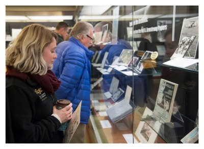 """Visitors view some of the items and papers from the Neil A. Armstrong Papers collection, which are part of the """"Apollo in the Archives: Selections from the Neil Armstrong Papers"""" exhibit. The Wright Flyer fabric will be on display in the exhibit through August 16."""