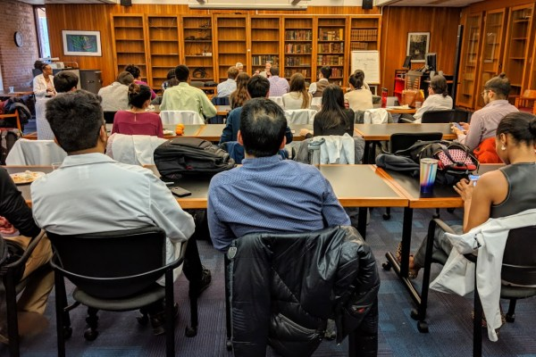 Photo of students meeting at the library