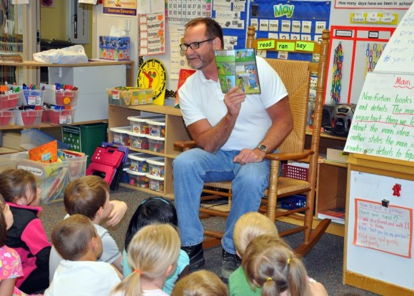 Brad Harrison reading to a class