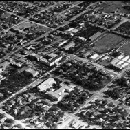 UNTA_U0458-091-150-01 A campus aerial image shows the campus, circa 1940. The first football field is at the top of the image. The tennis courts are located to the right of the football field. Below that is the Orchestra Hall and across the street is Chilton Hall. Marquis and Terrill Halls are located in the lower portion of the image. The Library is located below and left of the football field.