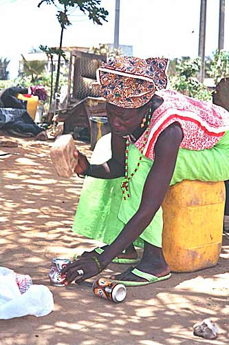 Sylvia-CHANT-Recycling-tin-cans-for-cooking-pots-GAMBIA