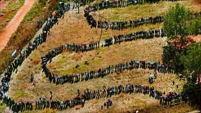 Black South Africans waited in long queues to cast their ballot for the first time in 1994 Credit: AP