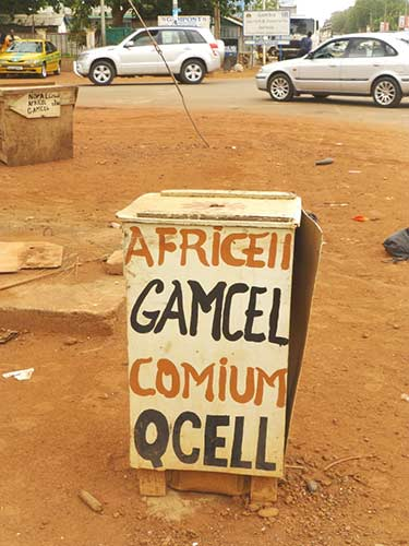 Gambia's ever-increasing suite of mobile providers rely heavily on informal operators to distribute their services © Sylvia Chant