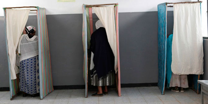 Ethiopians vote inside a polling station in the capital Addis Ababa on May 23, 2010 Photo Credit: Reuters
