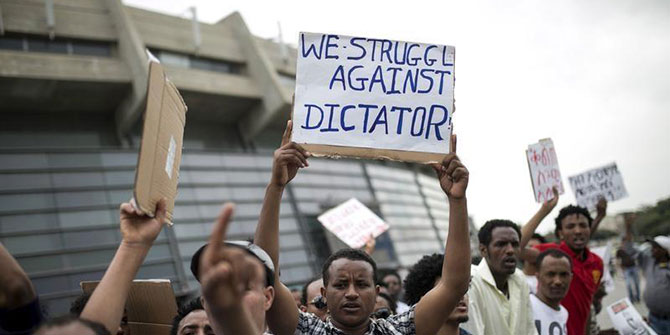 Eritrean refugees hold placards during a protest against the Eritrean government outside their embassy in Tel Aviv, Israel May 11, 2015 Credit: Human Rights Watch