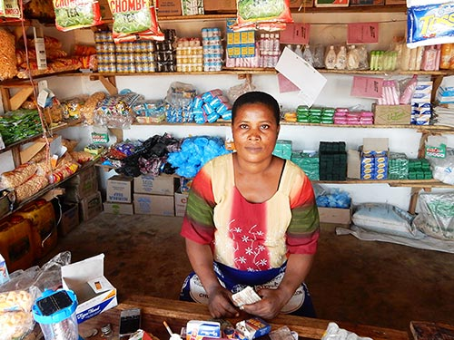Christina Charles sits in her grocery store in Ndirande