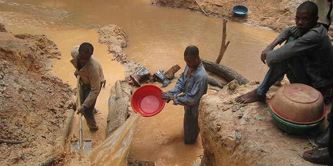The dropping price of commodities such as coltan and tantalum being mined in the photo
