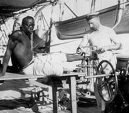 """""""Freeing a Slave from his Shackle on HMS 'Sphinx' off the East Coast of Africa 1907"""""""