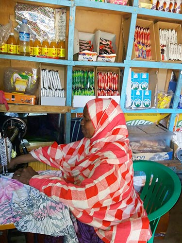 Shop owner in New Hargeisa now offering tailoring services Photo Credit: Nasra Jama