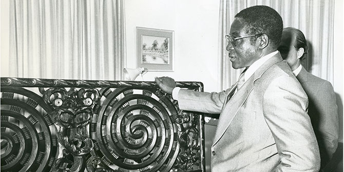 Robert Mugabe, then Prime Minister of Zimbabwe, admires a Maori carving, a gift from the government of New Zealand, during his country's independence celebrations on 18 April 1980 Photo Credit: Archives New Zealand via Flickr (http://bit.ly/2j8UUjz) CC BY-SA 2.0