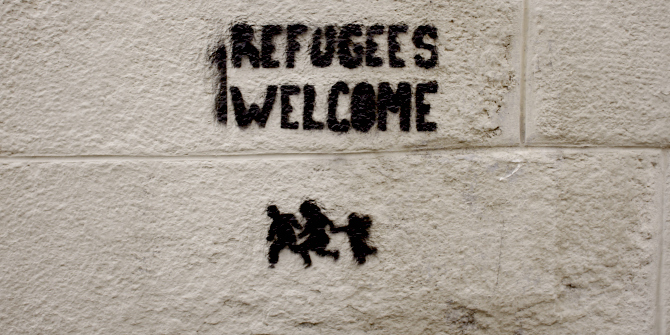 Refugees Welcome graffiti on a wall