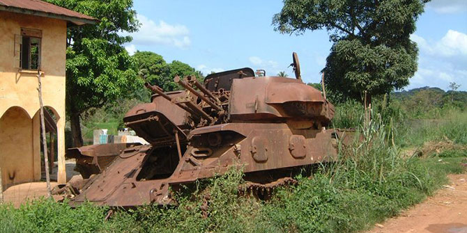 Burned out Nigeria tank on the road in Sierra Leone