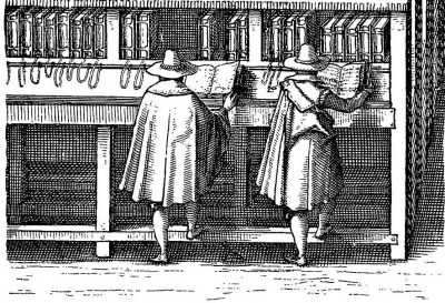 Two men standing, backs turned, at a reading table in a medieval library