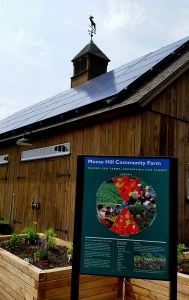 welcome to the farm, barn, solar array and bird garden raised beds