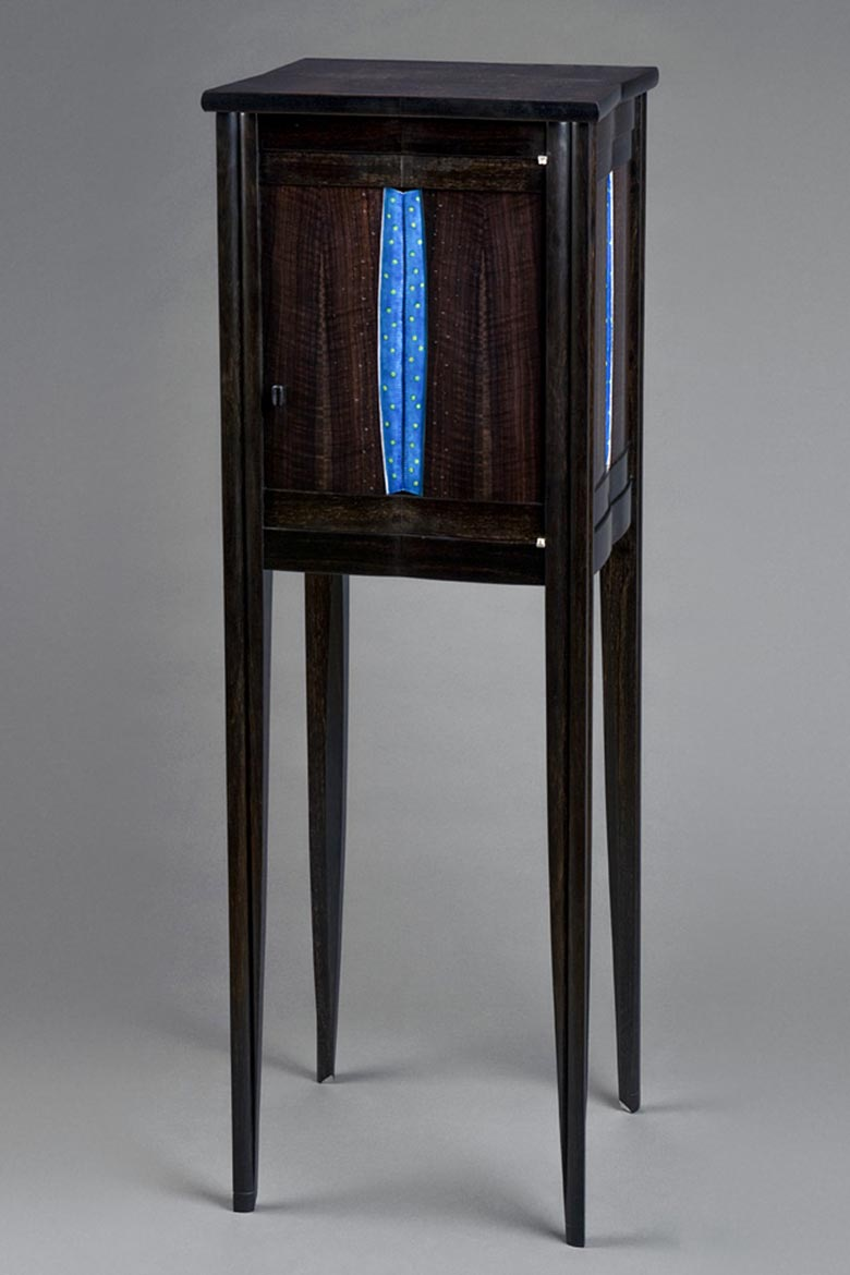 Dark wood furniture piece with metal accents