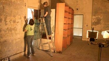 students scrape walls