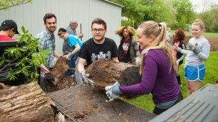 students lift logs